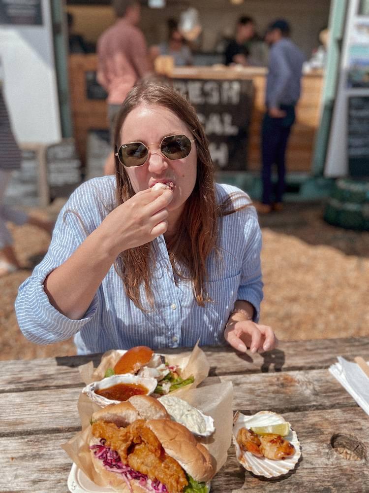 Thalia eating the food at Dungeness fish hut