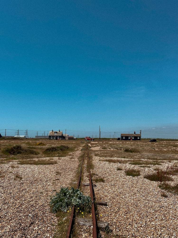 An old railway line in the middle of two cottages in Dungeness