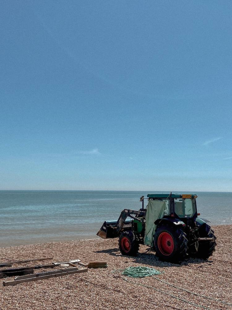 Tractor on the edge of Dungeness beach