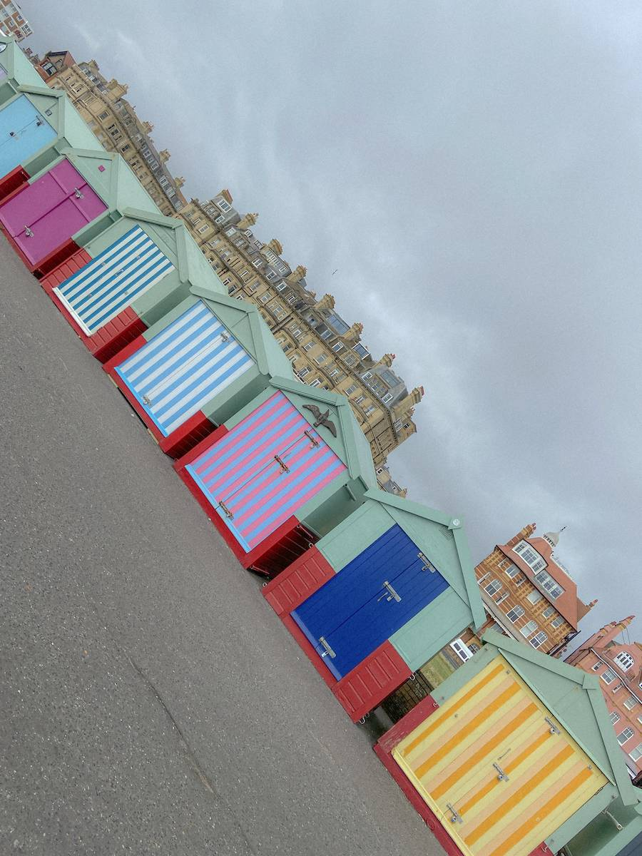 The colourful beach huts in Brighton taken on my uk summer staycation tour