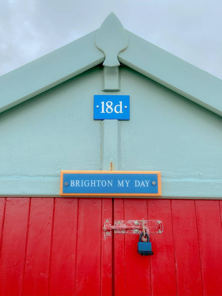 A colourful beach hut in Brighton, stop 1 on our UK summer staycation tour