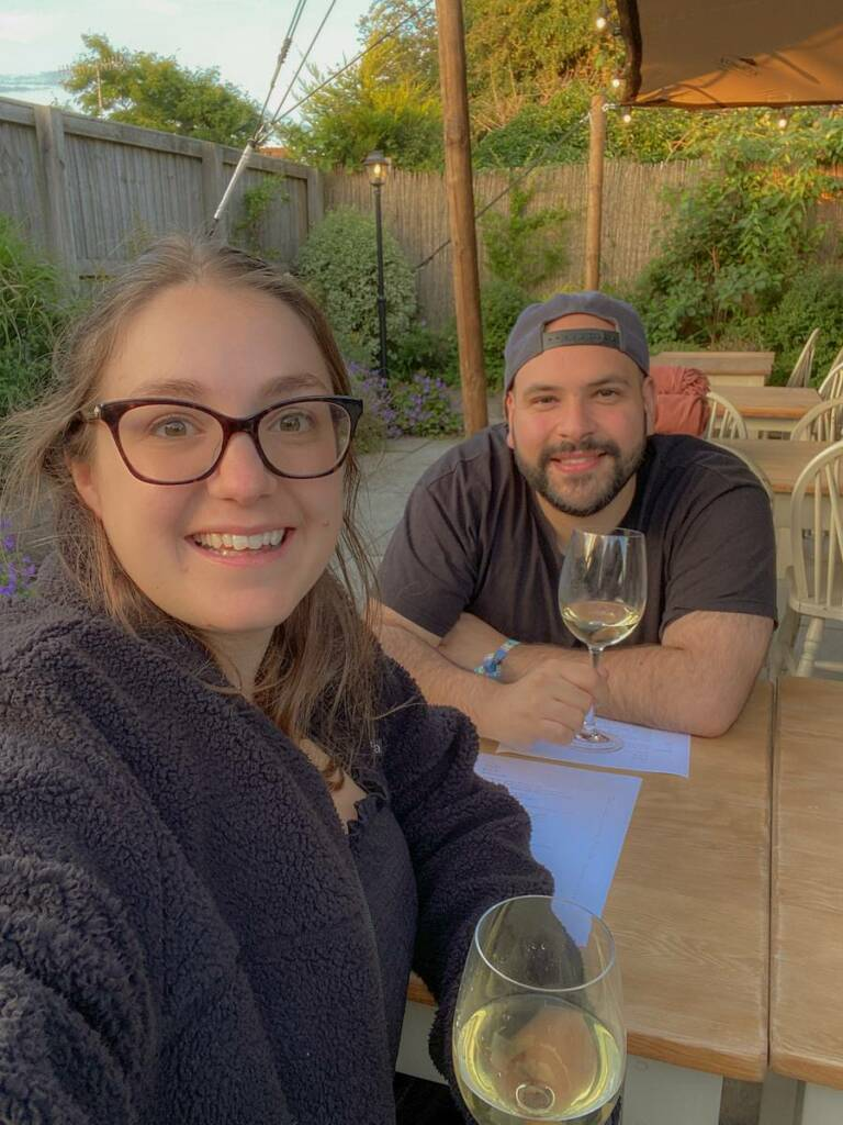 Notes by Thalia and her partner John posing for a selfie in a country pub on their UK summer staycation